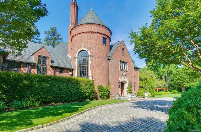 The Tudor-style home features a prominent, cone-roof-topped turret. Images courtesy CVRMLS.