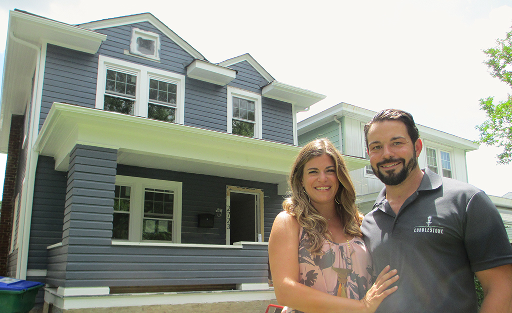 Breese and Josh Romano in front of 2723 Edgewood Ave., one of the 40-plus homes they're on track to remodel by the end of this year. (Jonathan Spiers)