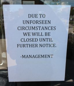 A sign posted on the door announces Family Meal's closure. (J. Elias O'Neal)
