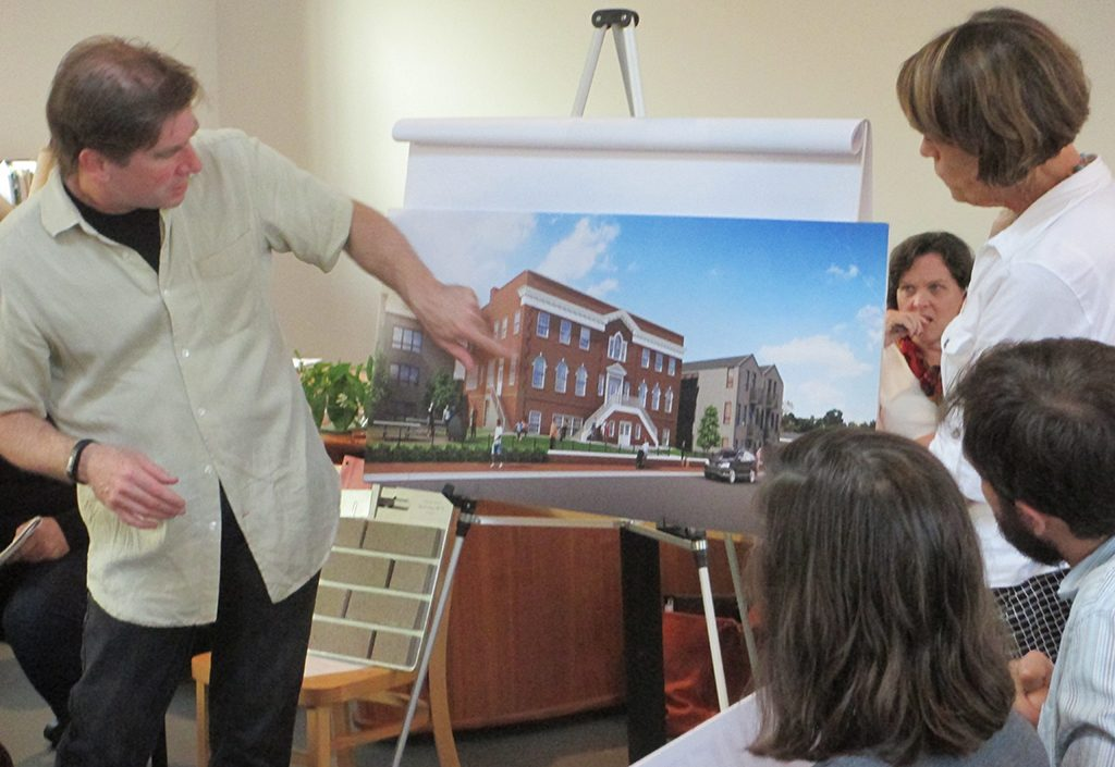Architect Walter Parks points out features of the redesigned Citadel building. (Jonathan Spiers)