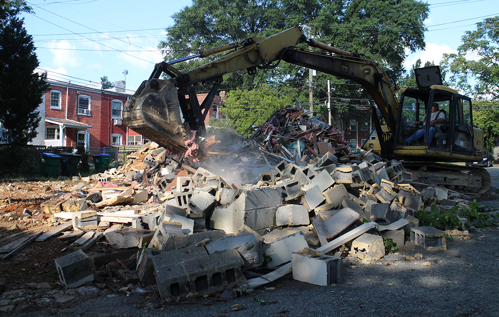 Demoliton began on a one-eighth-acre plot between rowhouses lining South Mulberry Street and Parkwood and Grayland avenues