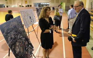 Jane Ferrara of the city's economic and community development department discusses the project with attendees. (Jonathan Spiers)