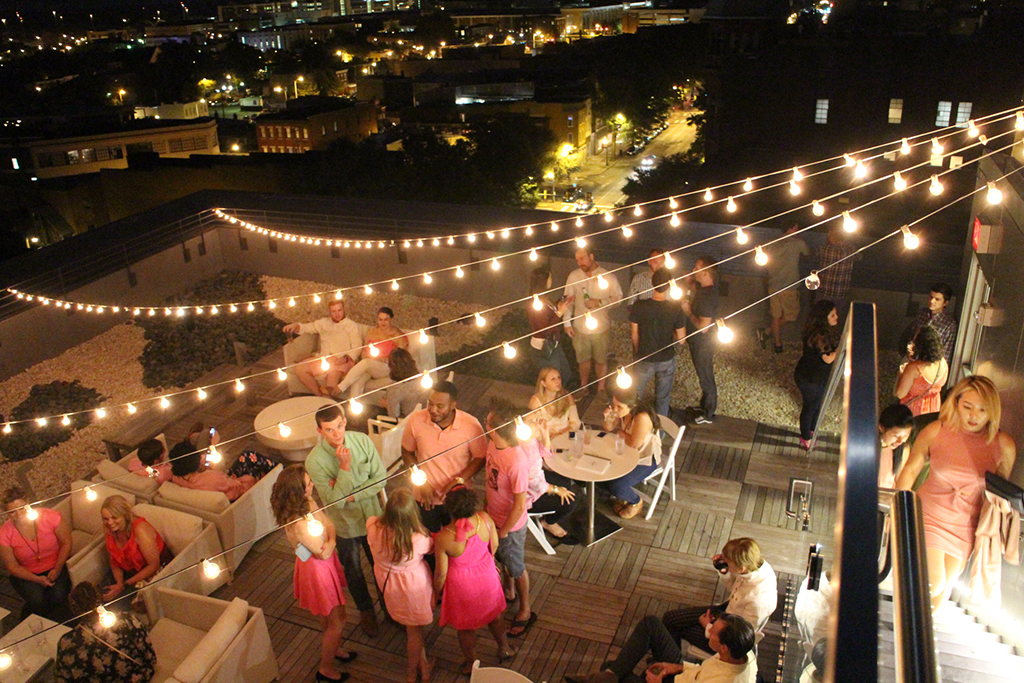 Attendees were encouraged to dress in pink and drink rosé on Quirk's popular Rooftop Bar and Terrace. (Jonathan Spiers)
