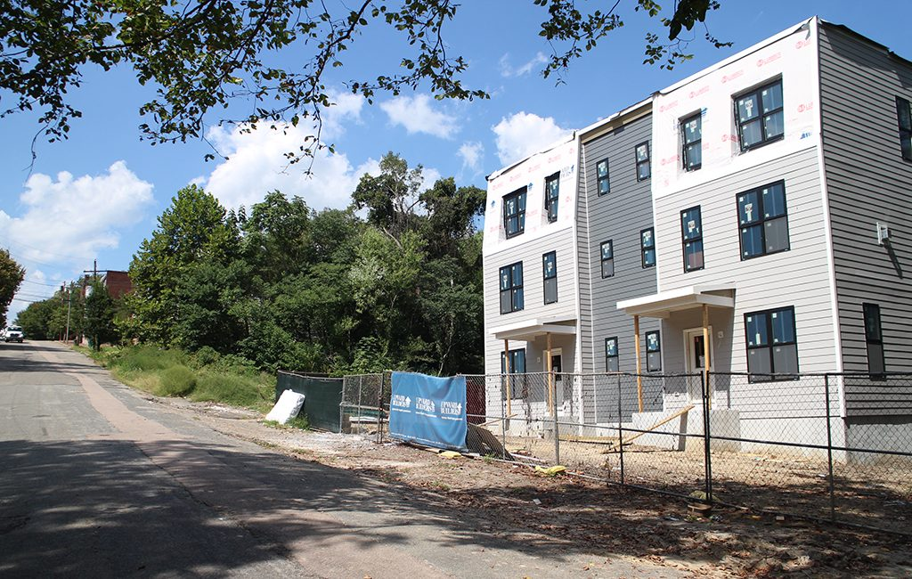 The first of several new homes planned for the Sugar Bottom area are going vertical at the end of East Franklin Street, downhill from Libby Hill Park. (Jonathan Spiers)
