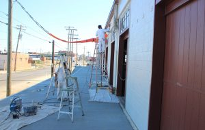 Crews continue work on Vasen's patio fronting West Moore Street in Scott's Addition. (J. Elias O'Neal)