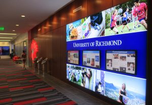 The center's main hallway includes a touchscreen video wall.