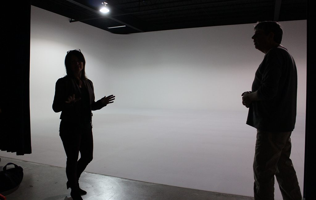 Stacy Murphy and Dave Trownsell in front of the 40-by-60-foot shooting space, a literal blank canvas. (Jonathan Spiers)