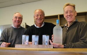From left: Gary McDowell, Sterling Roberts and Paul McCann in the Cirrus Vodka tasting room. (J. Elias O'Neal)
