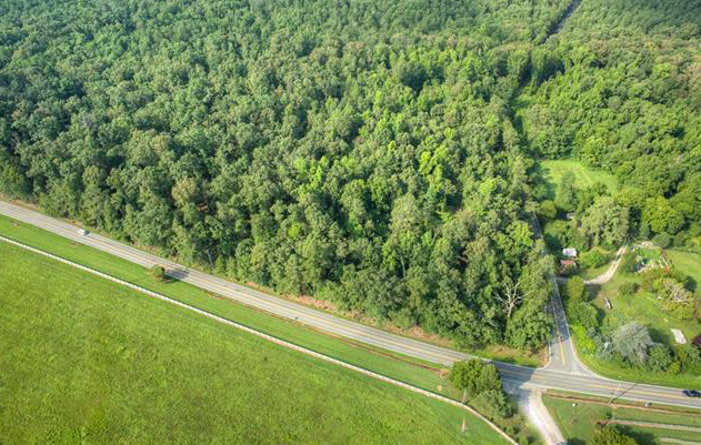 The mostly undeveloped, largely wooded land straddles Manakintown Ferry Road just south of Huguenot Trail. (Courtesy CVRMLS)