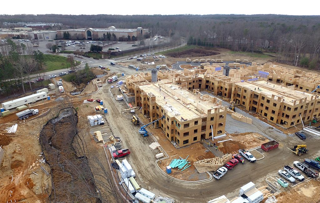 Apartments being built at the 27-acre site just north of Dillard's at the mall's northern end. (Kieran McQuilkin)