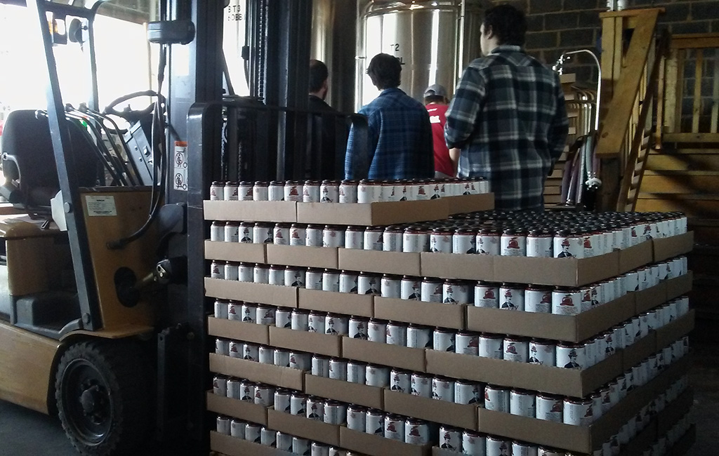 Buskey ciders stacked after the canning process in Buskey Cider's outpost. (Mike Platania)