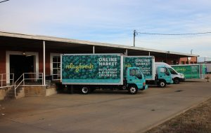 Relay Foods trucks await deliveries at the Scott's Addition distribution warehouse.