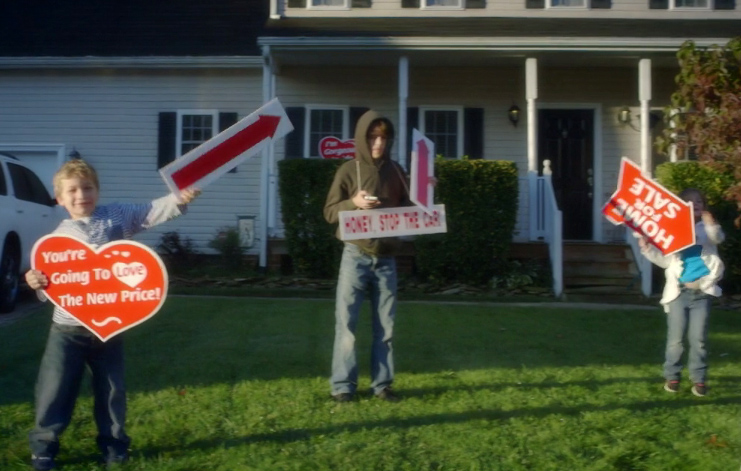 """One RAR commercial shows a homeowner resorting to having children spinning """"for sale"""" signs in her front yard."""