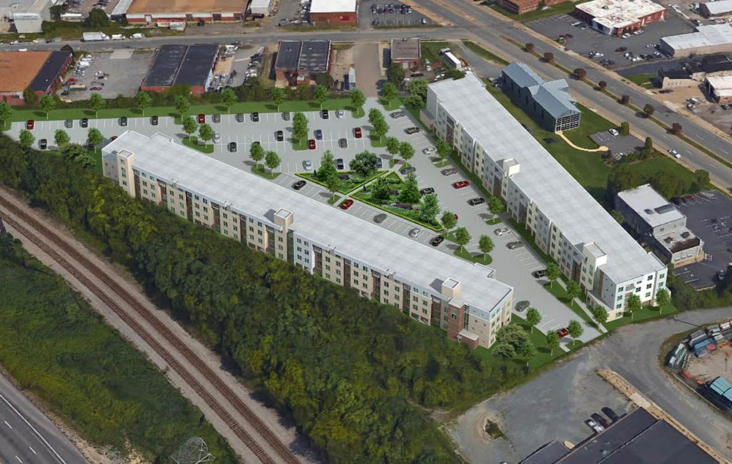 Plans call for two buildings comprising 200 apartments and straddling a central surface parking lot.