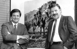Stephen with his brother David Martin, right, beside a picture of their father, cowboy-adman Hawley Martin. (Courtesy Stephen Martin)