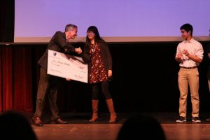 Head of School Dan Frank presents the $200 first place prize to Amanda Wang.