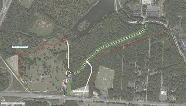 A map distributed at recent meetings shows a planned connector road between West Creek Parkway and the planned project site, outlined in red.