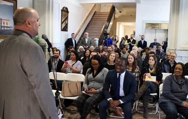 Project Homes' Lee Householder addresses attendees at Wednesday's ribbon-cutting. (Jonathan Spiers)