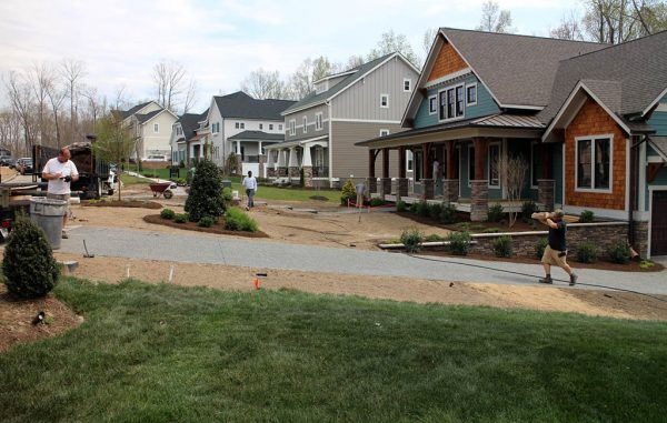 Builders put finishing touches on homes at the Hallsley model home court. (Jonathan Spiers)
