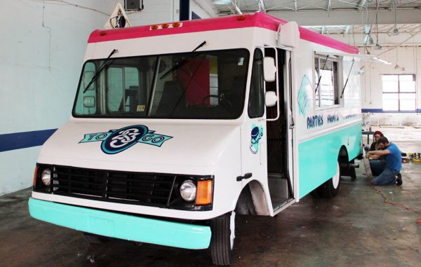 The nonprofit refurbished a 1999 GMC Savana to offer mobile printing services. (Mike Platania)