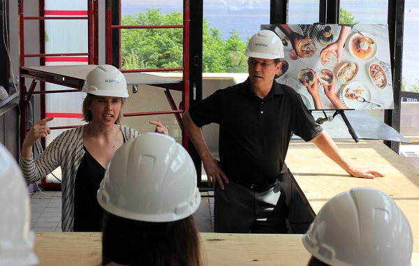 Paige and Kevin Healy inside the construction site. (J. Elias O'Neal)