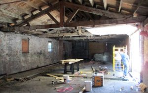 The original trusses and brick walls will be incorporated into the apartments' design. (Jonathan Spiers)