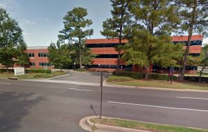 A pair of vacant office buildings at 4240 and 4300 Cox Road were sold for $6 million. (Google Maps)