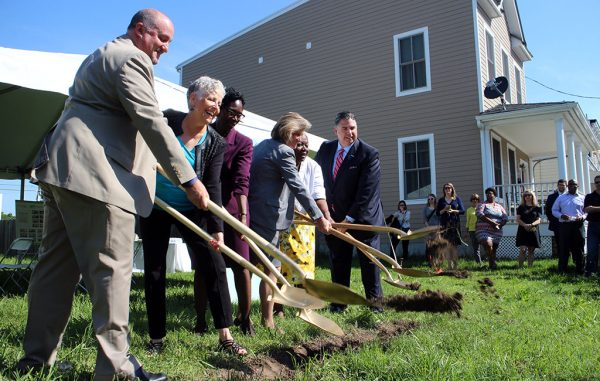 Officials break ground on the 26th Street site, where construction was slated to begin Thursday. (Jonathan Spiers)