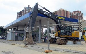 Work is underway to tear down Uphoff's Sunoco gas station at the corner of North Belvidere and West Grace streets. (Jonathan Spiers)