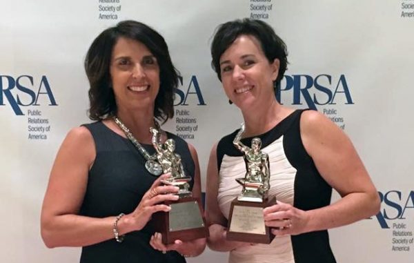Virginia Lottery's Jill Vaughan, left, and Jennifer Mullen with the Silver Anvils the lottery won for its work with Padilla.