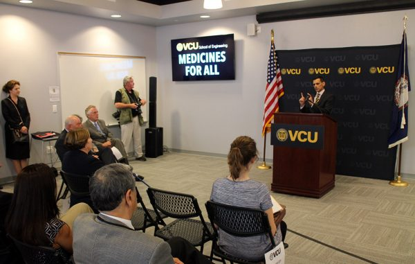 VCU President Michael Rao addresses attendees at Thursday's announcement in the Biotech Eight building. (Jonathan Spiers)
