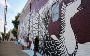 """Last year, ndp had an artist """"tattoo"""" the building with a mural as part of its marketing campaign for a Japanese tattoo art exhibit at the Virginia Museum of Fine Arts. (Jonathan Spiers)"""