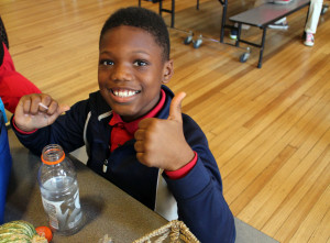 Third-grader Qadir Faulk at lunch. The school gives students two meals and a snack for free each day.