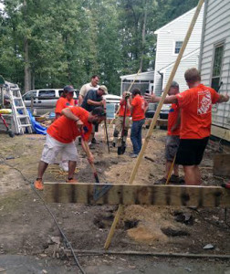Home Depot employees volunteered with Habitat for Humanity to build homes for veterans.