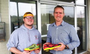Natural running store employee Austin Archer, left, and founder Patton Gleason